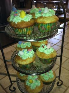 """This picture was taken last year for my oldest sons Easter party at school. All I did was make vanilla cupcakes and top with green colored frosting using a Wilton tip 2010 to make """"grass"""". I then added some small flowered-shaped sprinkles and then top with one or two small malt-chocolate eggs."""