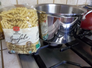 While cutlets are baking, heat a large pot of water.  Cook pasta as directed on bag.