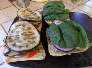 Add your spinach to the onion side.  On the other half stack some of those peppers and eggplant.  I put about pieces (or a half) of bell pepper and about 3 slices of eggplant on each half.