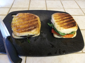 Once grilled to utter perfection, let rest on a cutting board for a few minutes.  Then slice in half.  Diagonally is always pretty...