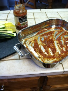 Using about a 1/2 cup of marinara - cover the bottom of a lasagna pan.